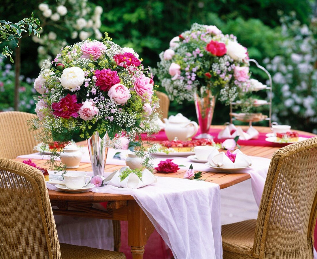 Festive bouquet made of peonies and baby's breath on a set table
