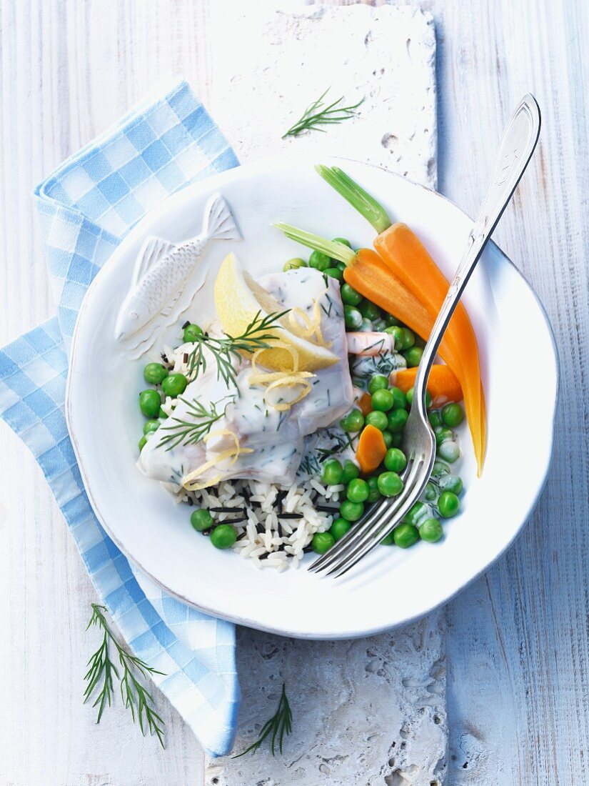 Fish stew made with rose fish, rice, peas and carrots