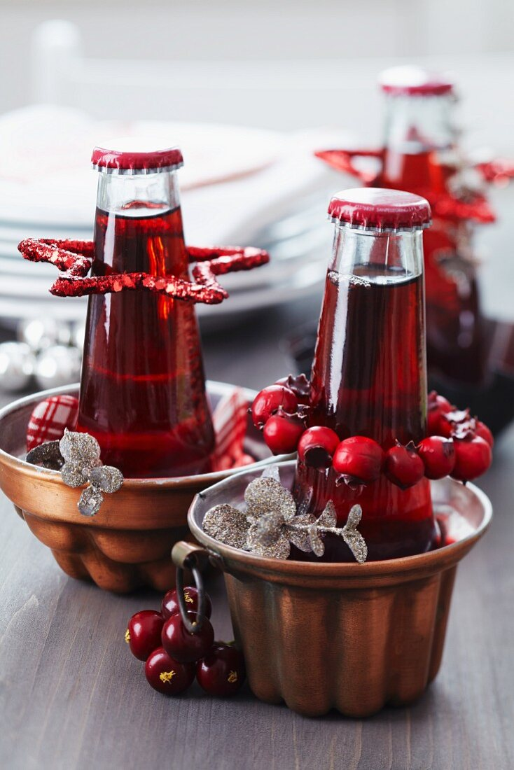 Copper jelly moulds used as bottle coolers and festively decorated