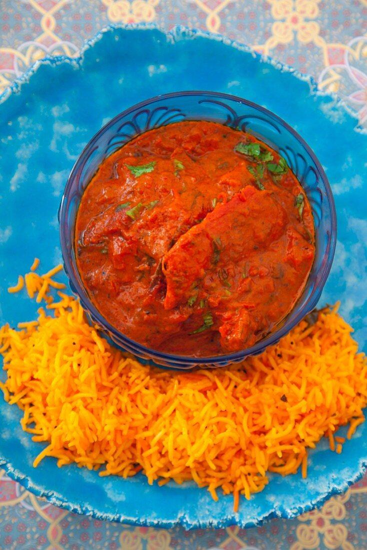 Chicken tikka masala (chicken pieces in a spicy sauce, India)