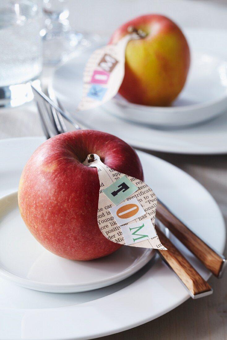 Newspaper name tags on apples