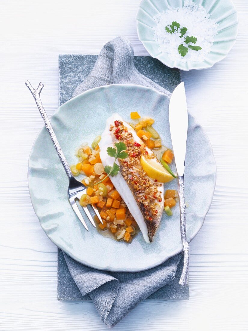 Pike-perch filet with spice crust on squash salad