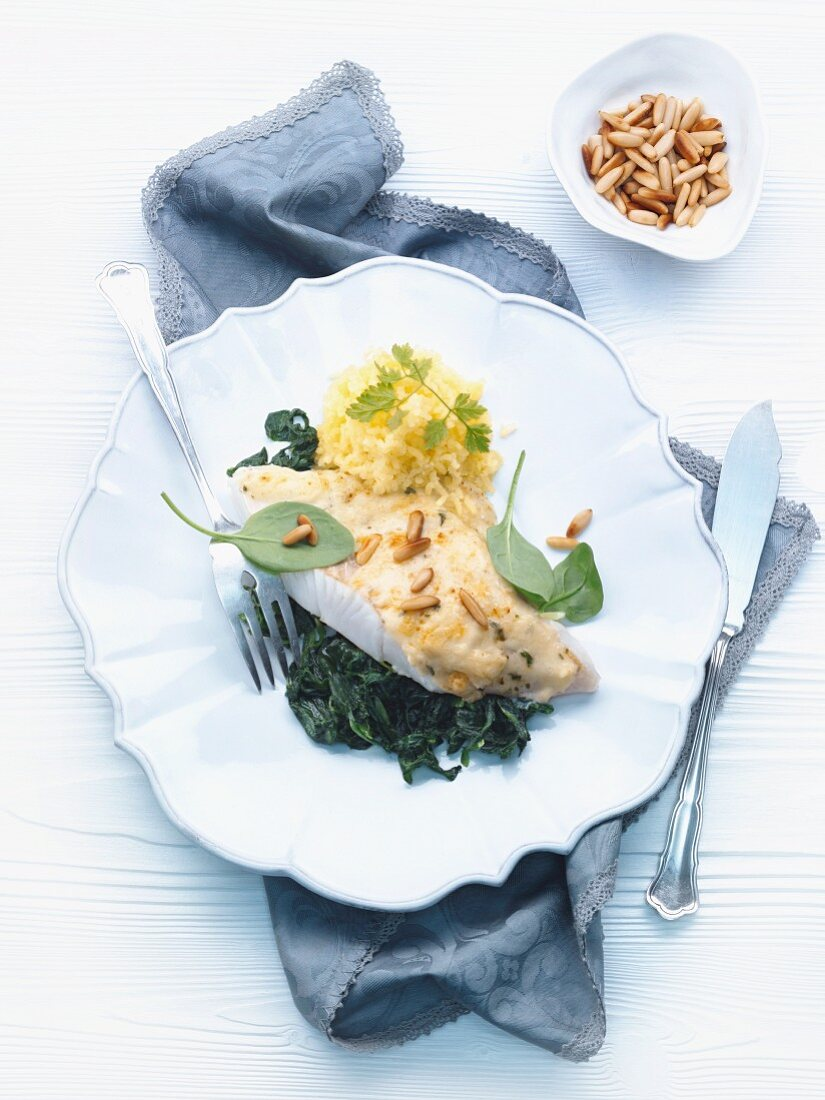 Florentine style Pike-perch fillet on spinach with pine nuts