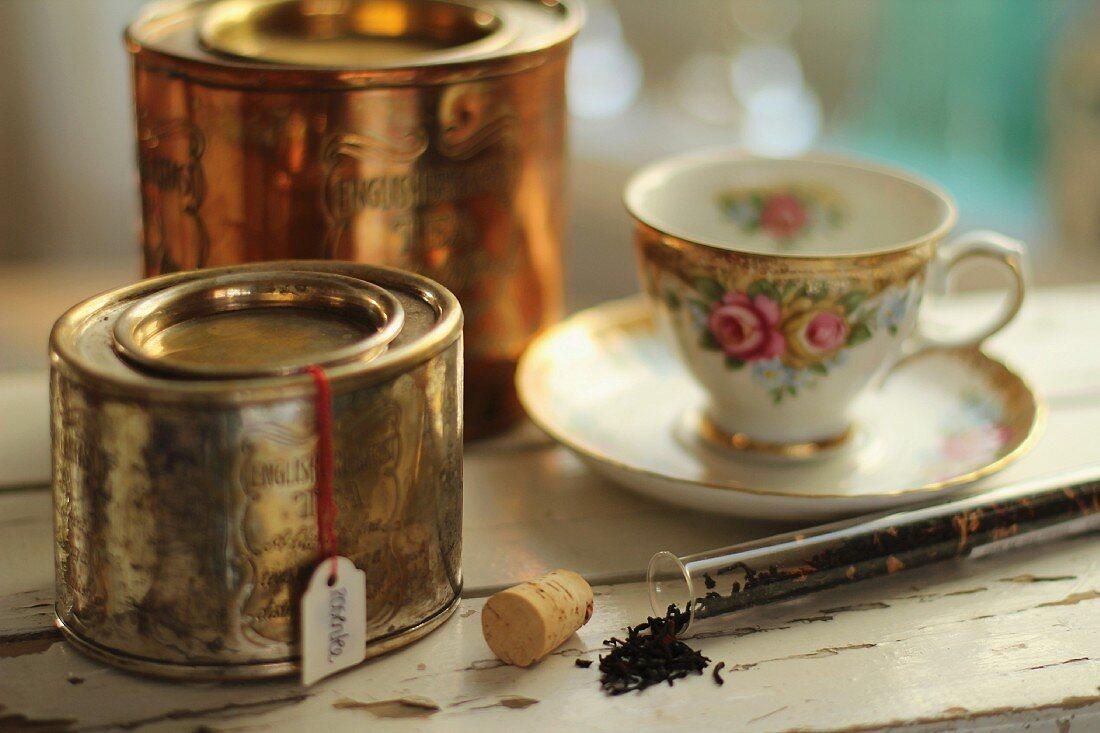 Rose tea, tea canisters and nostalgic rose tea cup