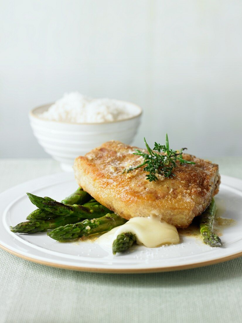 Veal cutlet with taleggio, asparagus and a side dish of rice
