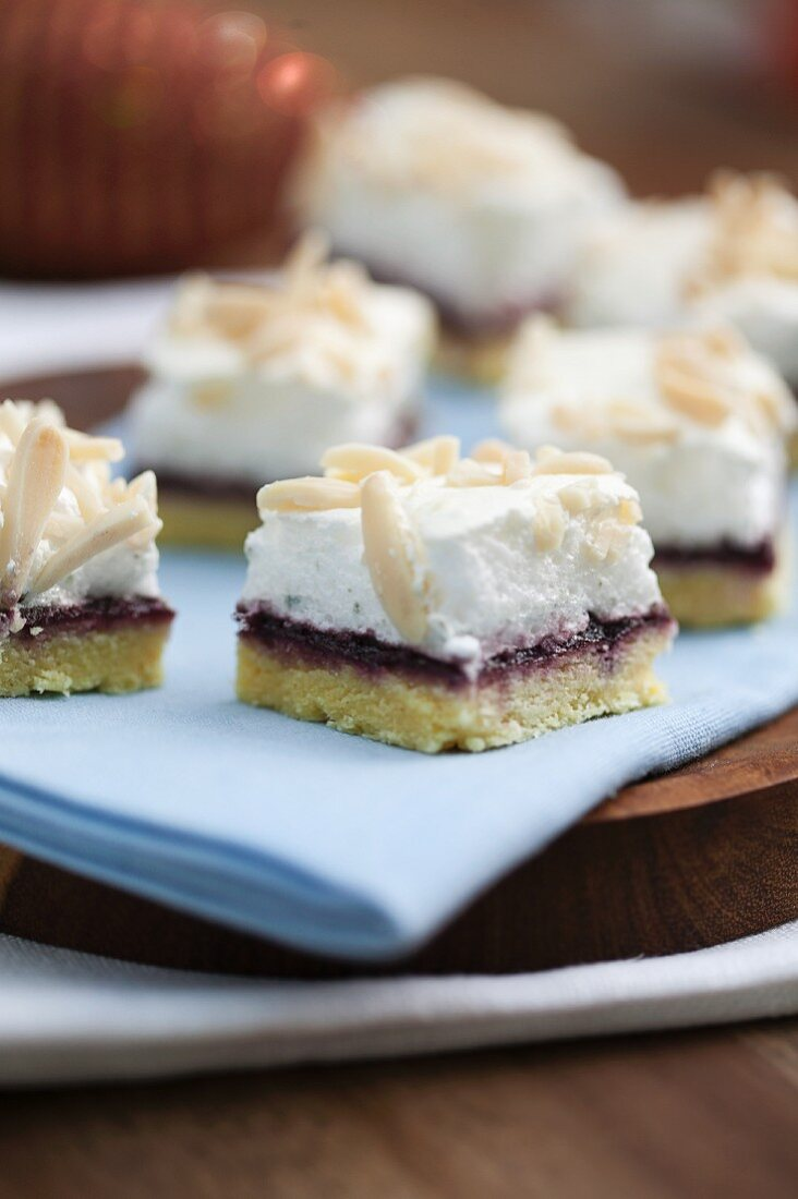 Cake with boysenberry jelly, meringue and sliced almonds