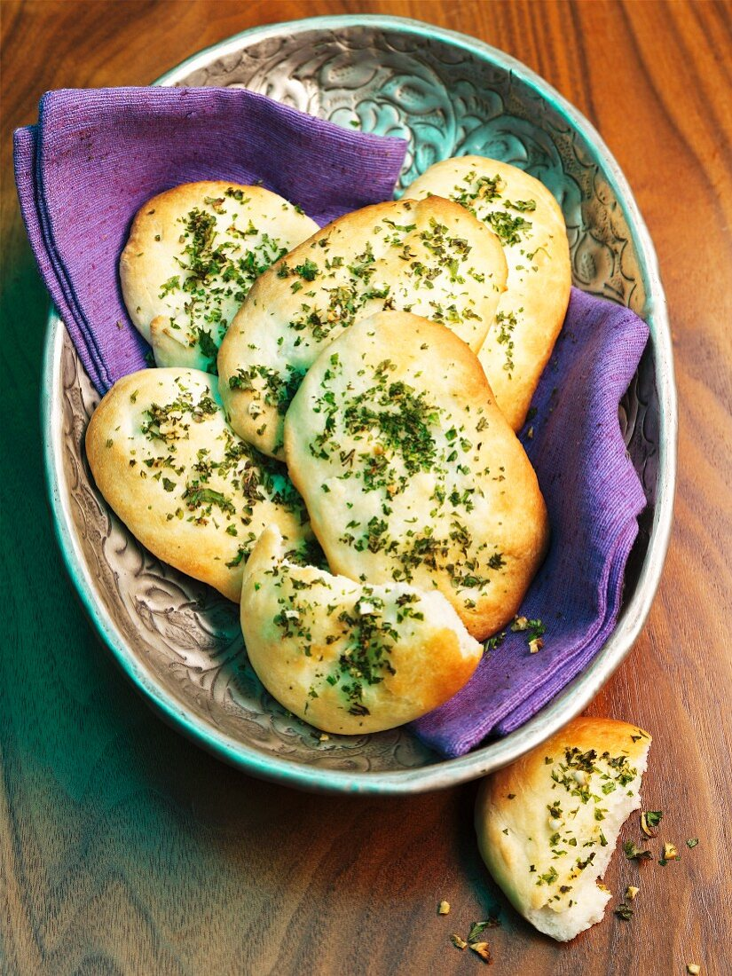 Naan breads with garlic and herbs