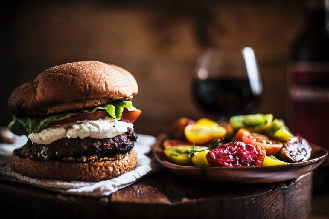 Hamburger with Goat Cheese, Lettuce and Tomato; Tomato Salad on the Side