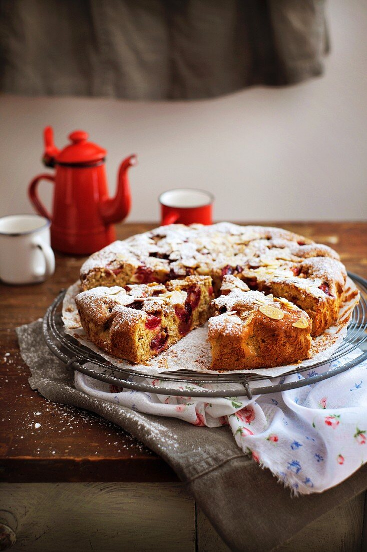 Rustic cherry cake dusted with icing sugar