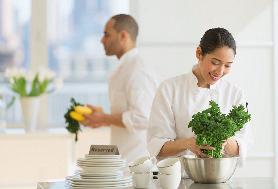 Two chefs preparing food in their restaurant