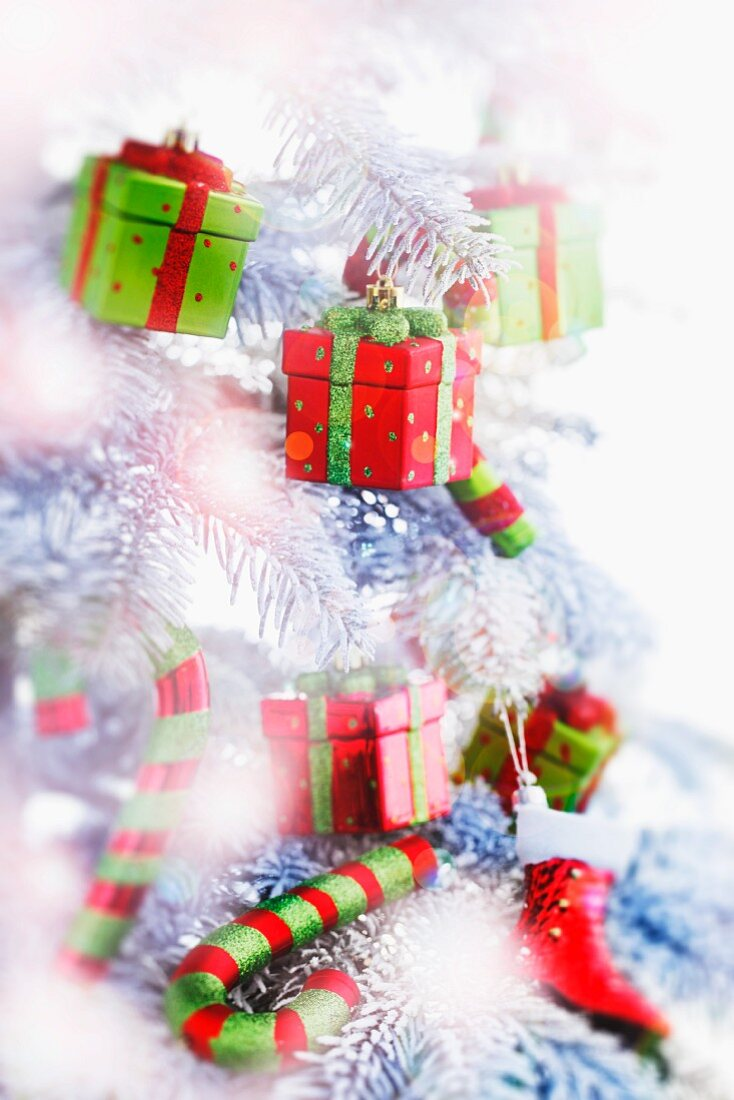 A Christmas tree with small parcels as decorations, and with candy canes