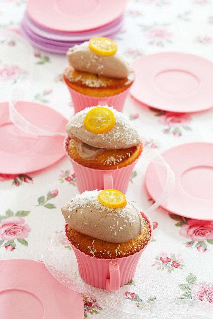 Orange and coconut cupcakes with a mousse topping