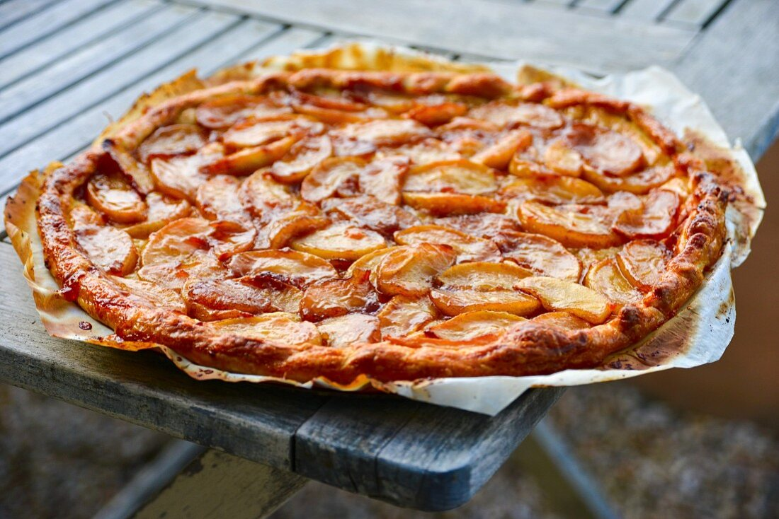 Apple tart on grease-proof paper