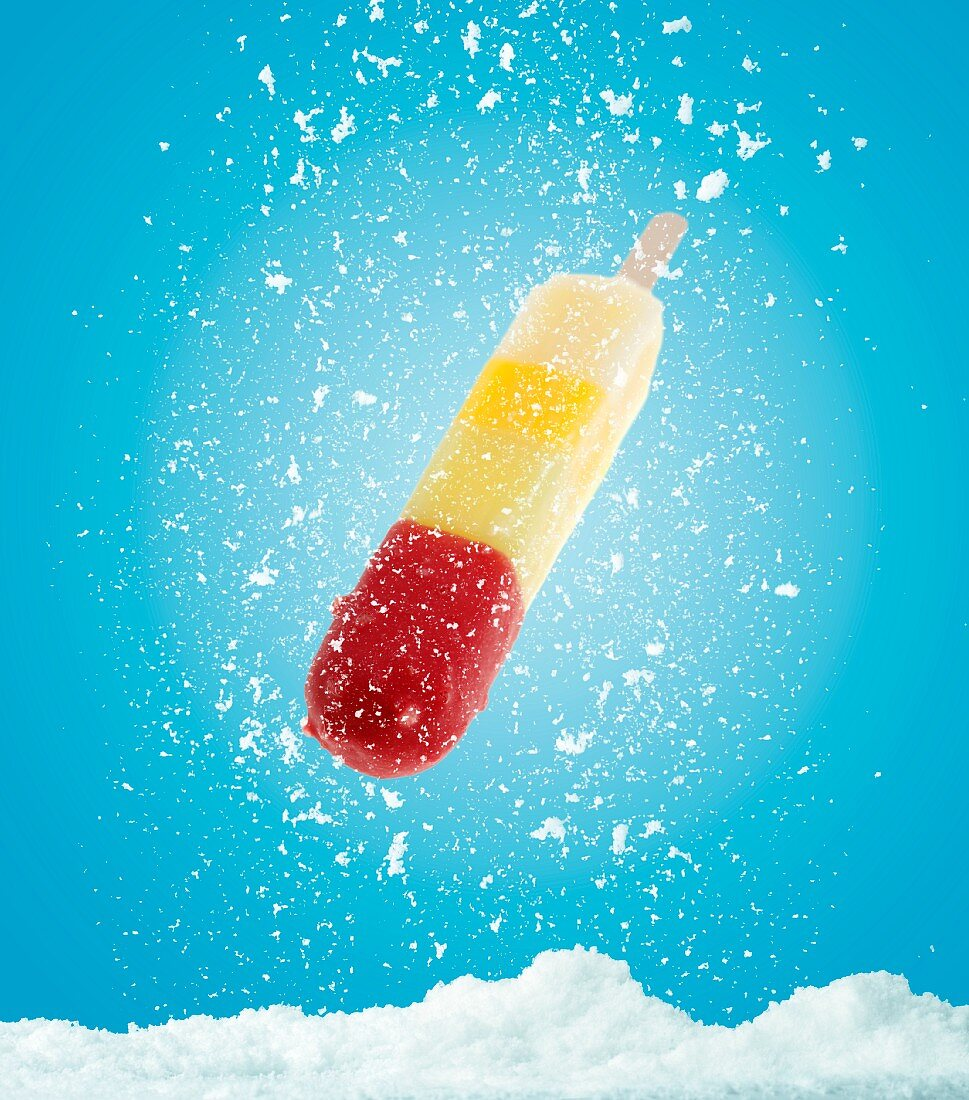 A fruit ice lolly with snow