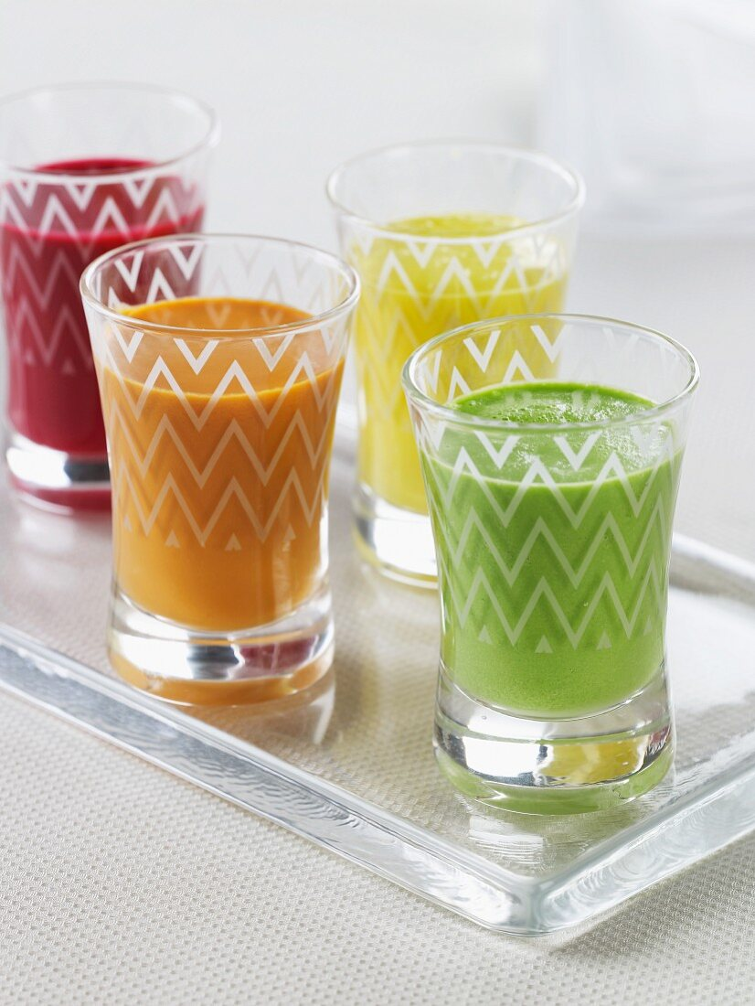 Four Glasses of Assorted Cold Soups; Beet, Cucumber, Tomato, Yellow Tomato