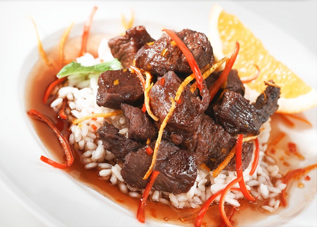 Beef ragout with orange sauce on a bed of rice