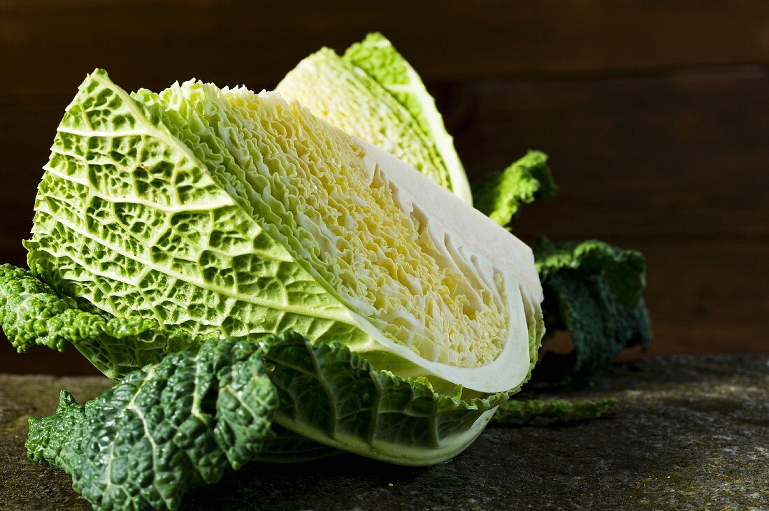 Savoy cabbage on a stone slab