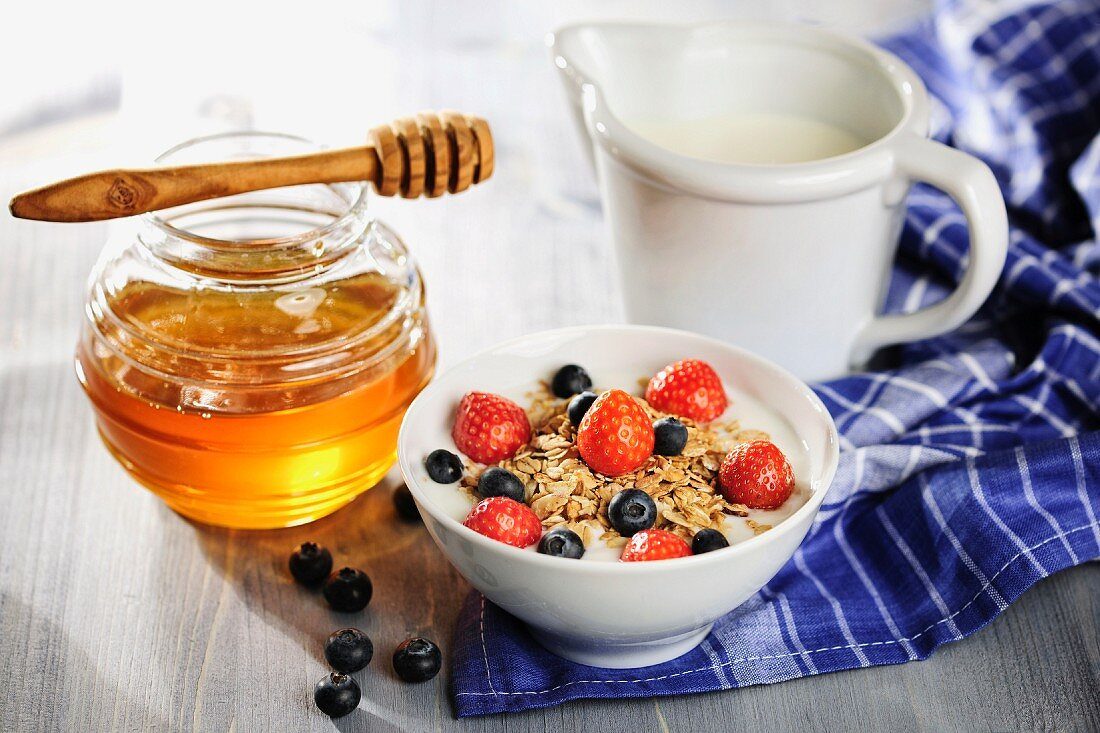 Muesli with fruits, milk and honey