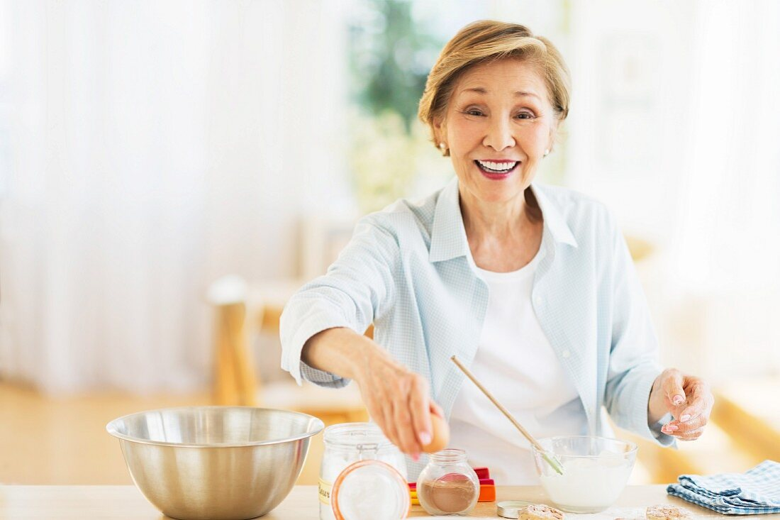 An older woman baking in the kitchen