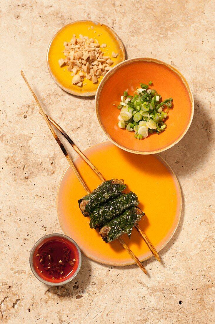 Bo la lot (beef in betel leaves, Vietnam)