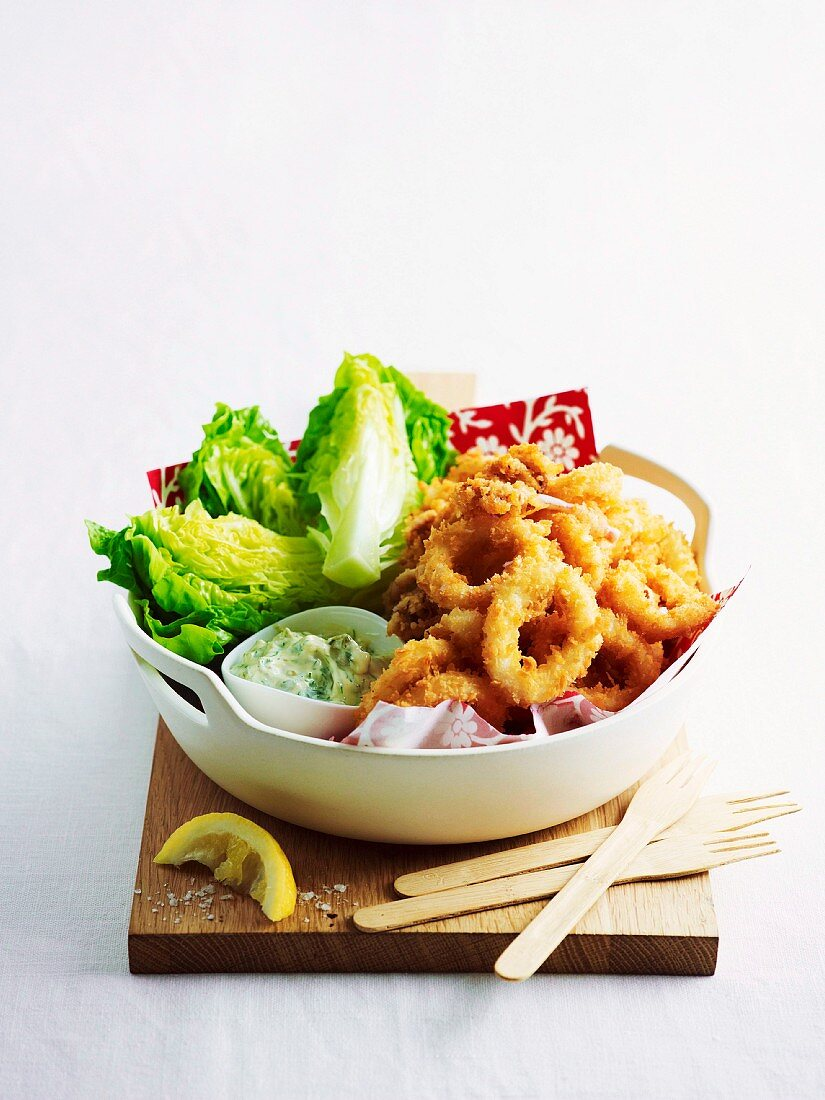Breaded squid rings with tartare sauce and lettuce hearts