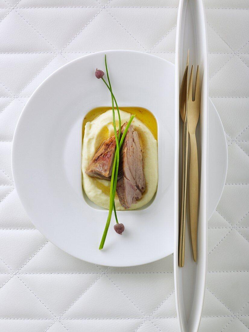 Shoulder of milk-fed lamb on mashed potato