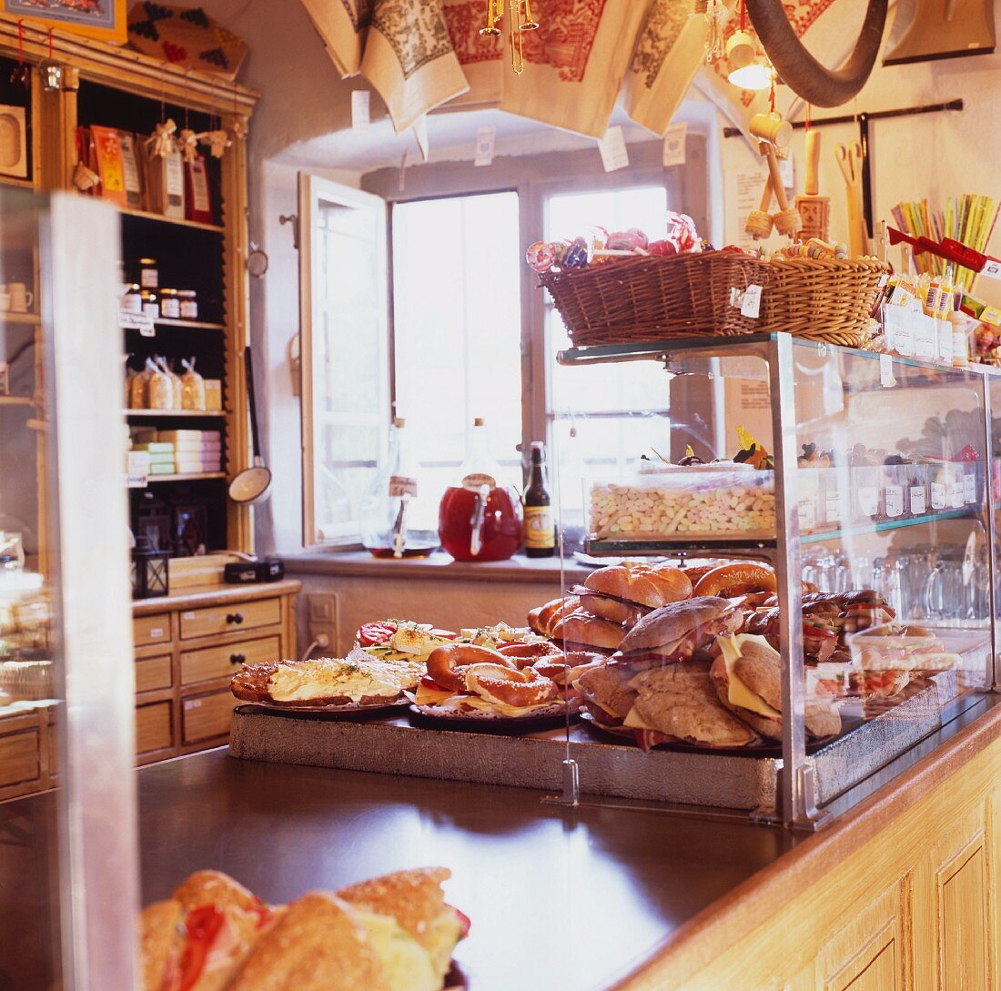 A rustically furnished shop floor with baked goods and other items for sale