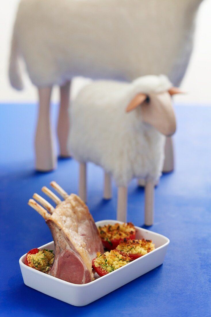 A rack of lamb with stuffed tomatoes