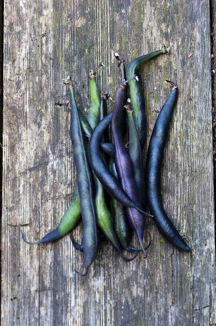 Violet beans on a wooden board