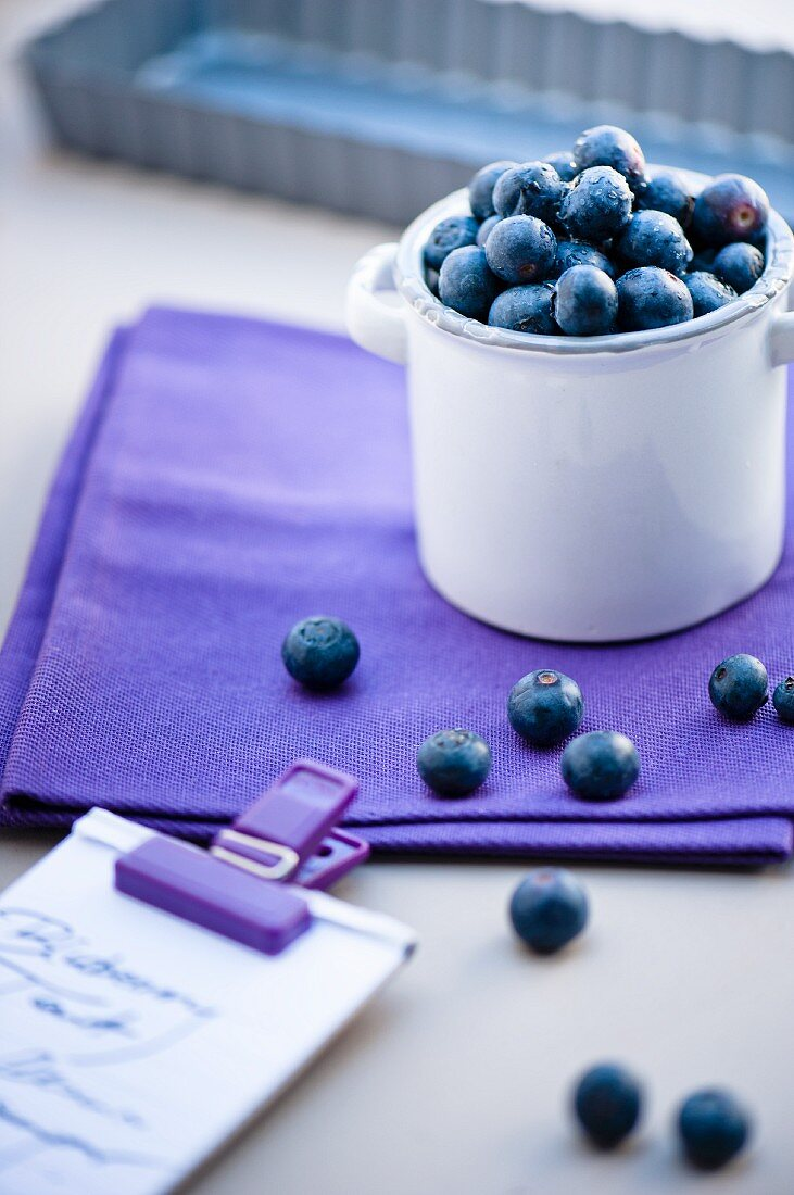 blueberries in a bowl with a shooping list