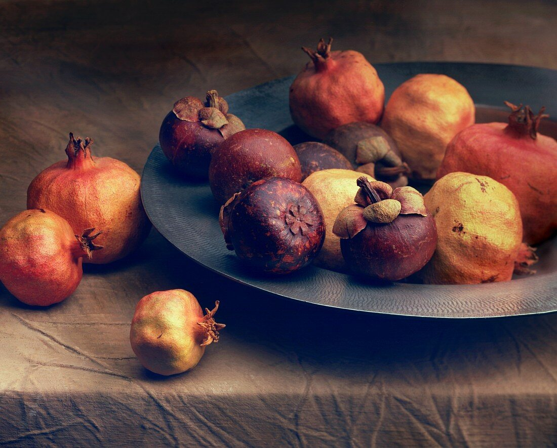 A still life featuring pomegranates (in the style of an Old Master)