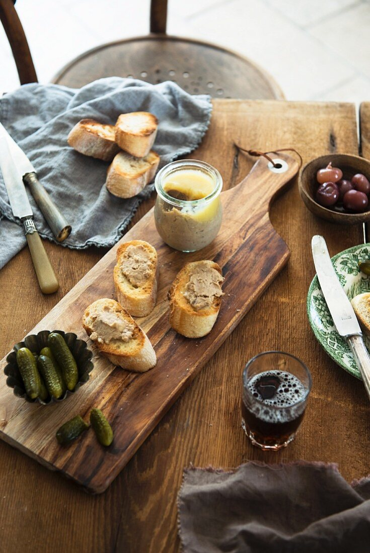 Rabbit rillettes, chunks of baguette, pickles and beer