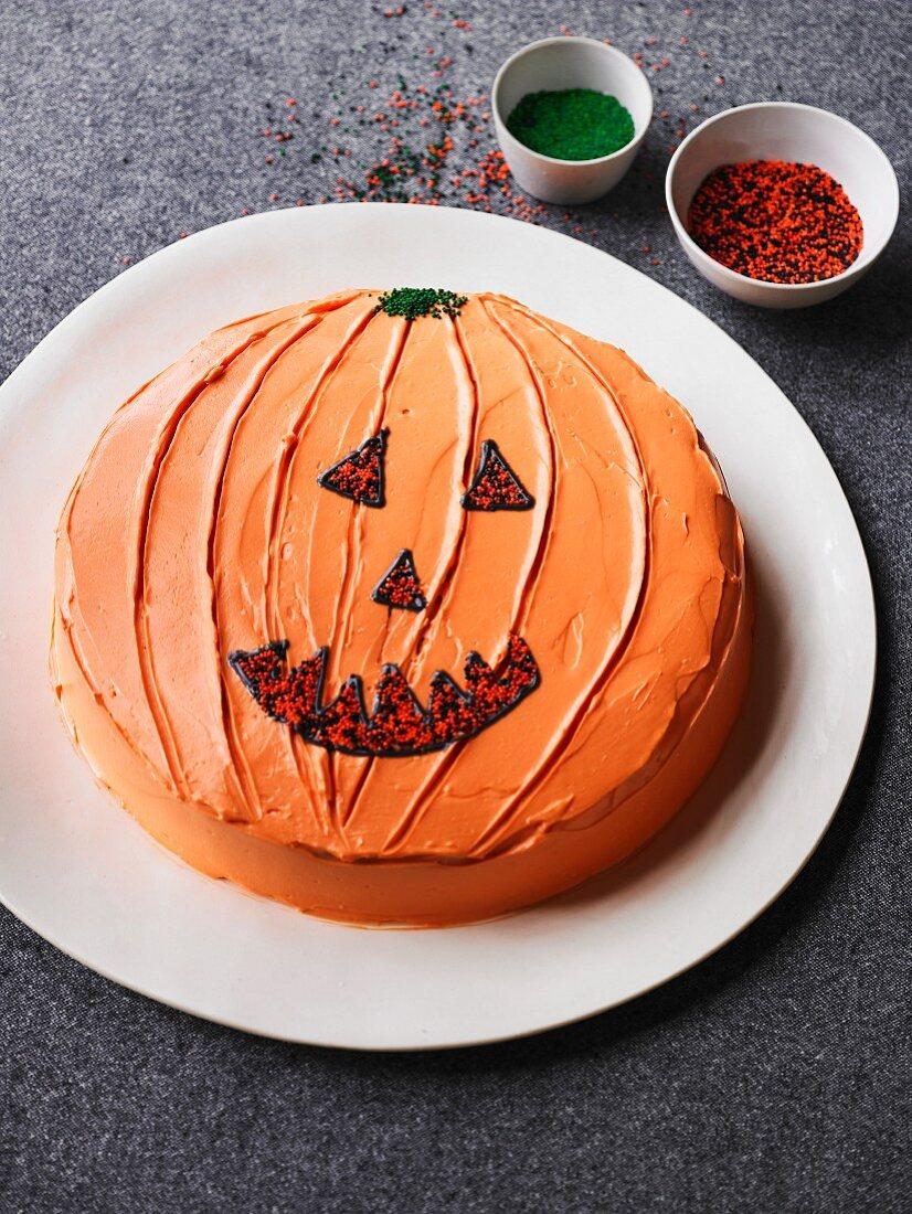 Pumpkin cake decorated with a jack-o'-lantern face