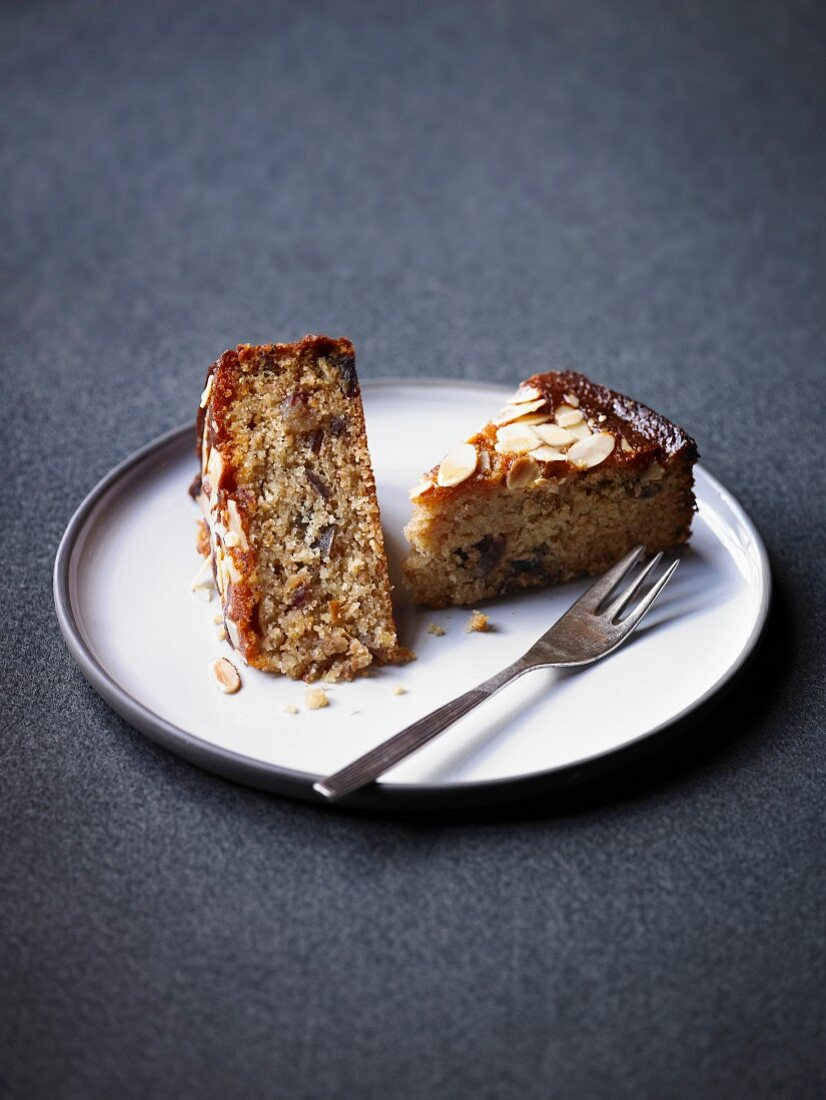 Two slices of honey cake with dates and almonds