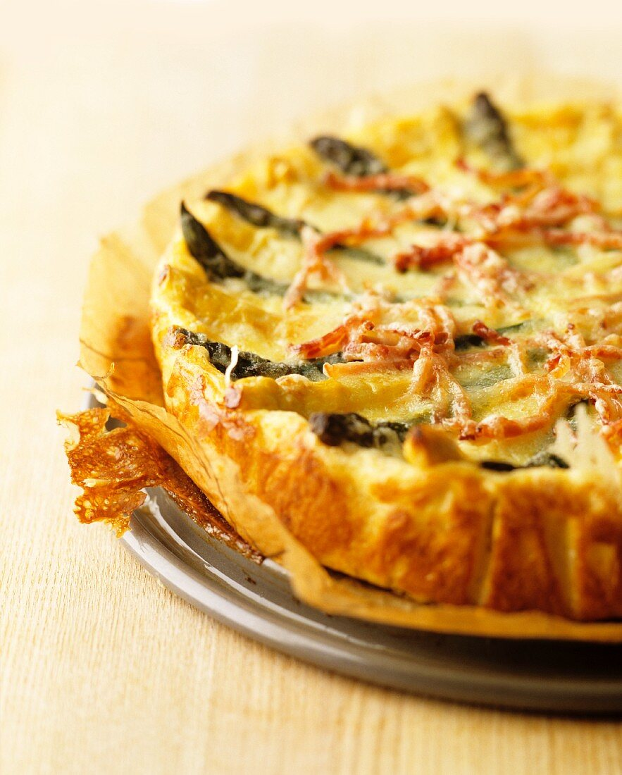 Asparagus quiche with strips of bacon