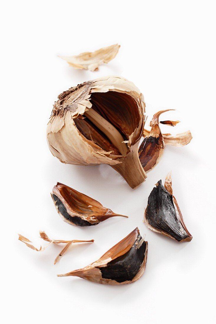 Fermented garlic against a white background