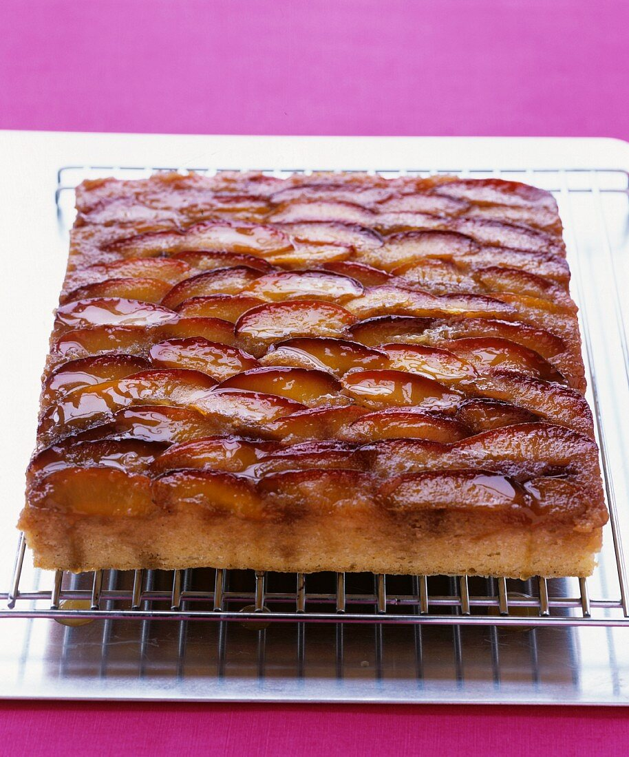 Plum cake on a cooling rack