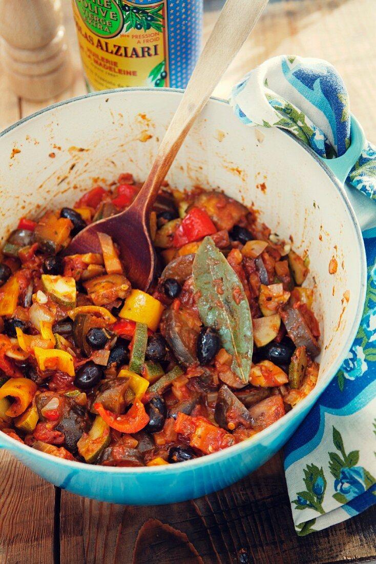 Provençal ratatouille in a blue enamel pot