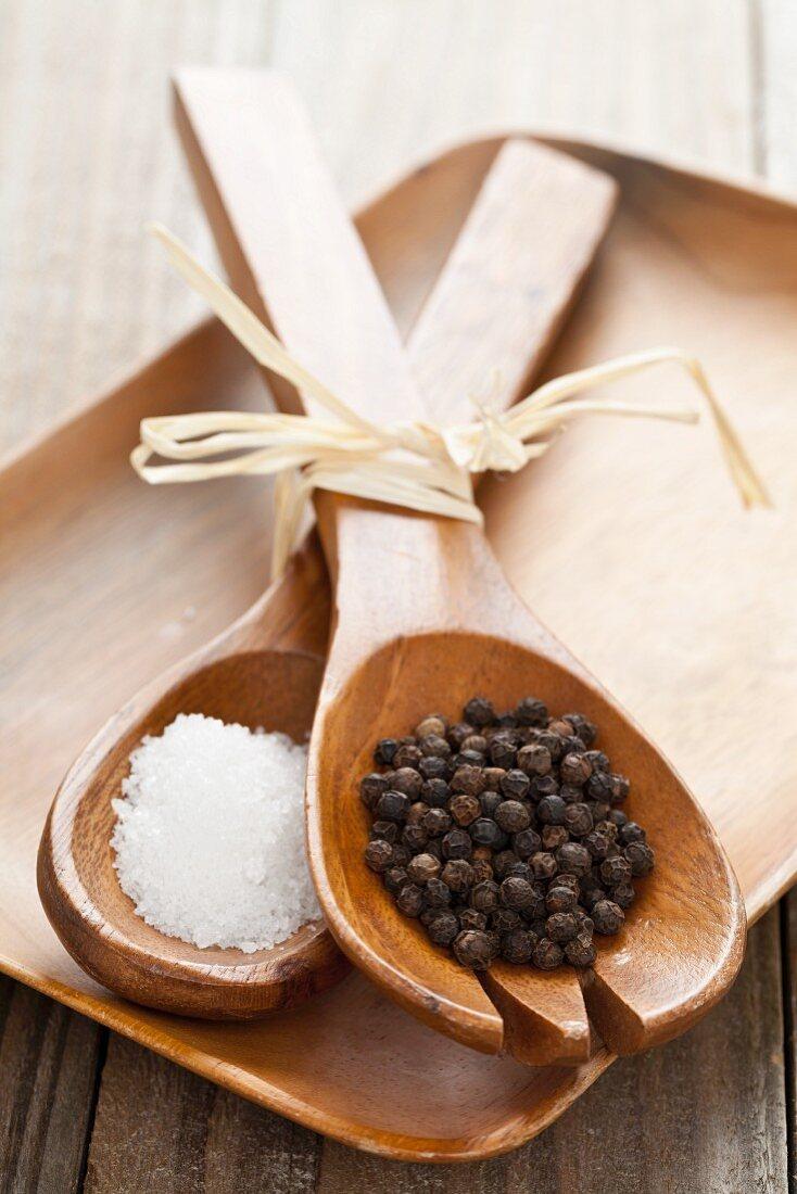 Fleur de Sel sea salt and black pepper on acacia wood salad servers