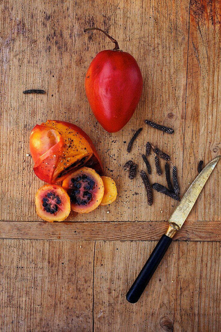 Grilled tamarillo with long pepper