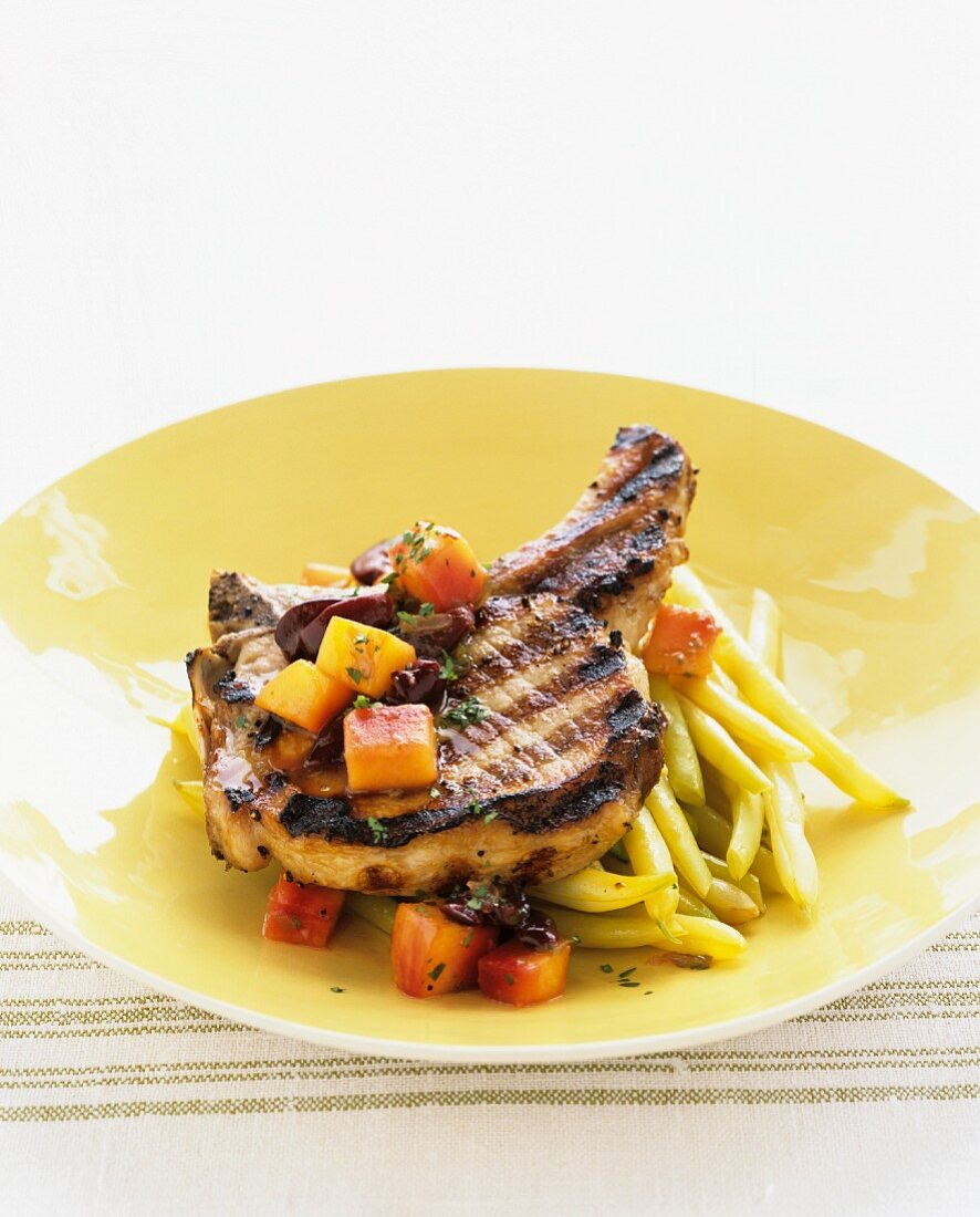 Grilled pork chop with yellow beans and carrots