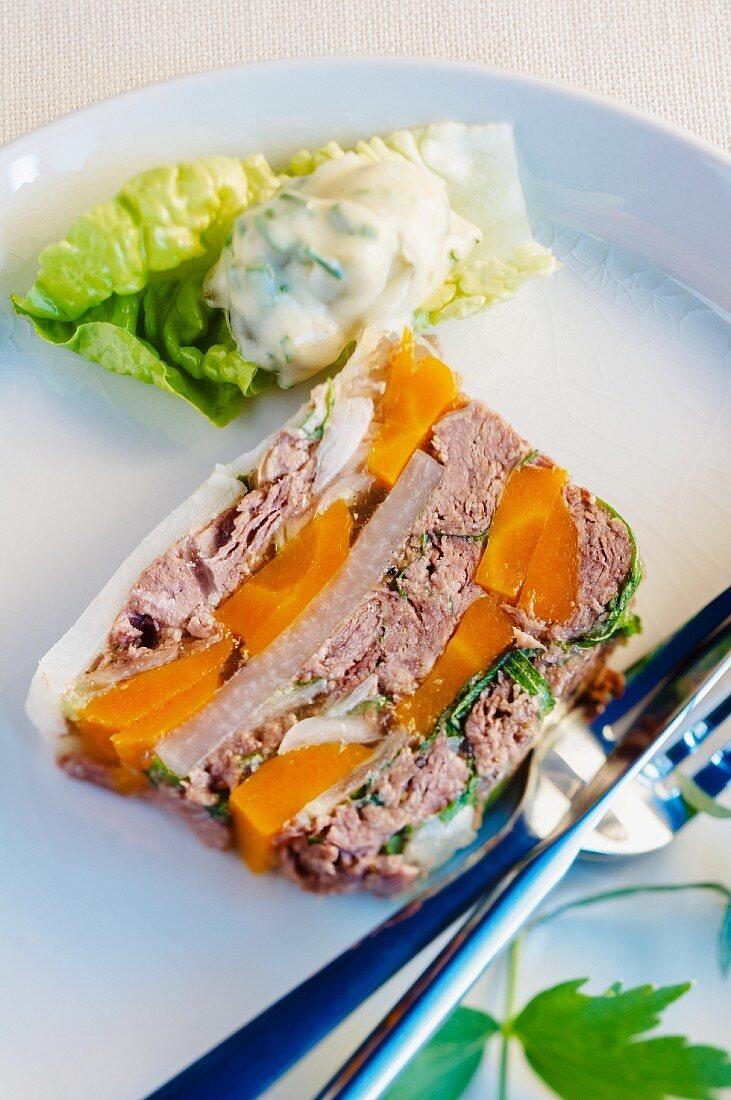 A slice of pot-au-feu terrine