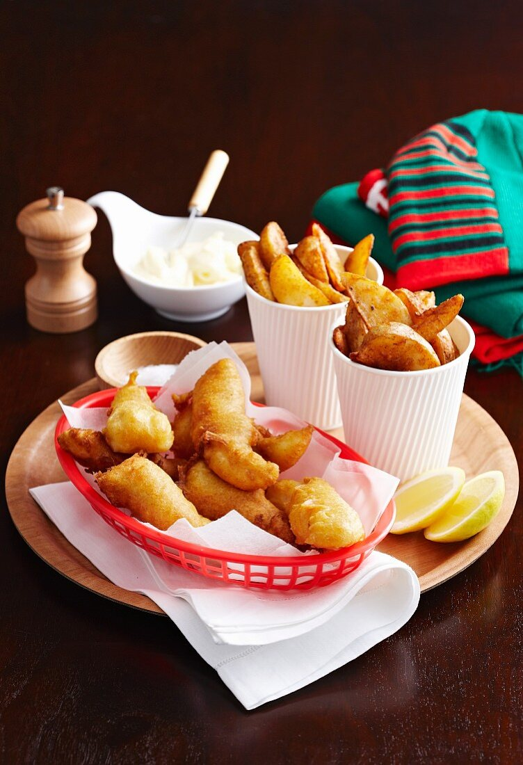 Beer-battered fish with oven-baked potato wedges