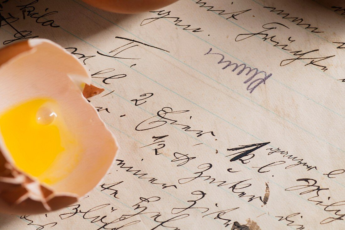 Detail of a recipe in old German handwriting, and an eggshell