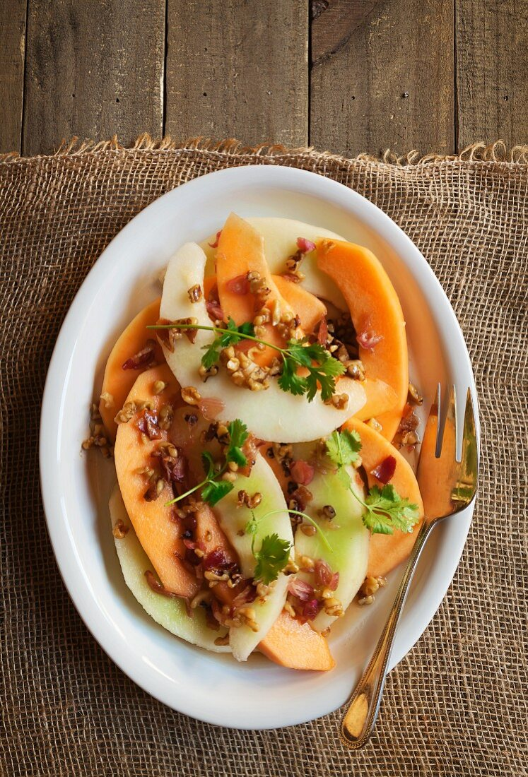 Honeydew and Cantaloupe Salad with Walnut Bourbon Maple Vinaigrette Topped with Bacon and Fresh Cilantro