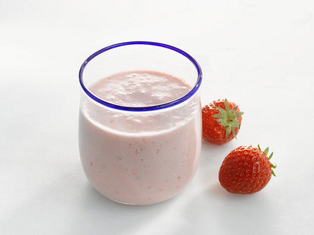 Glass of strawberry milk