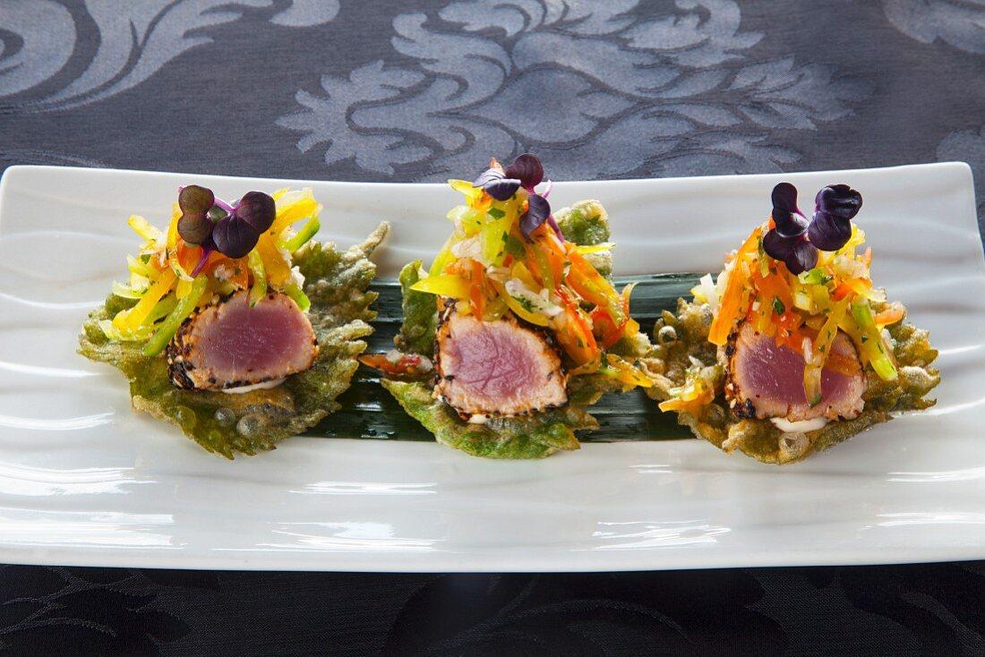 Seared tuna with togarashi on crispy shiso leaves