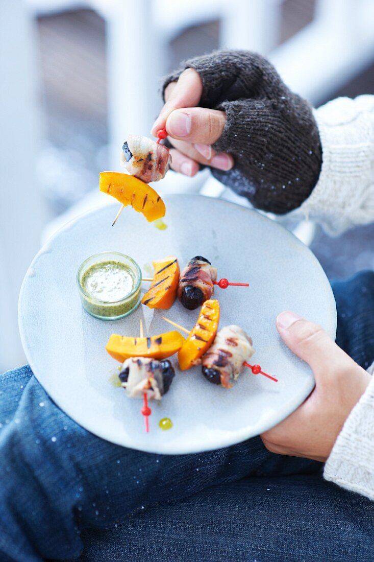 Bacon-wrapped-dates and pumpkin on sticks