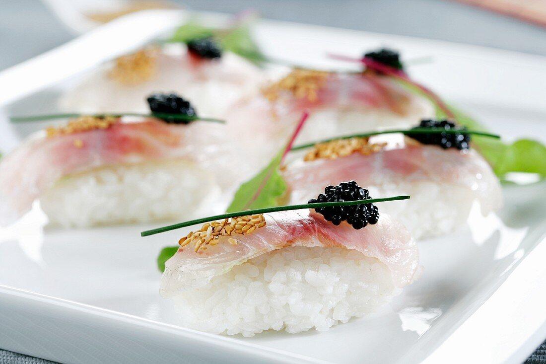 Nigiri sushi with seabream and caviar