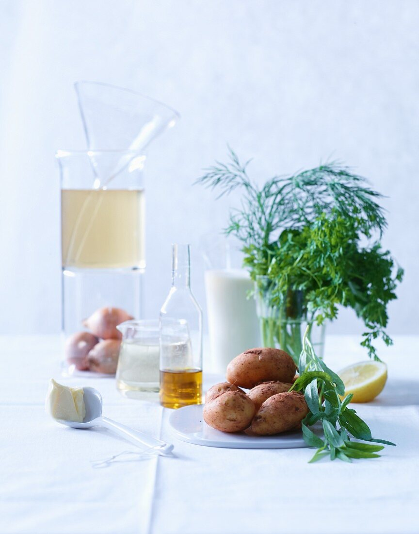 Ingredients for green herb soup with lemon cream